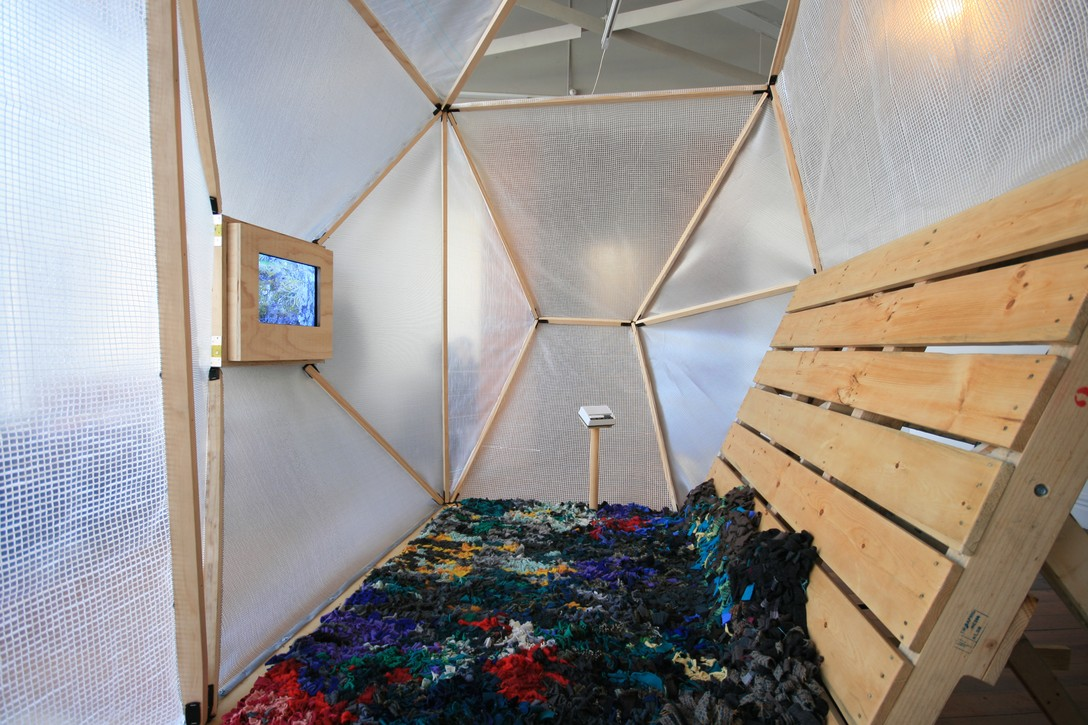 Andy Irving and Keila Martin, Apocalypse Tent, 2012, handmade rug and surveillance screen. Image courtesy of Lance Cash.