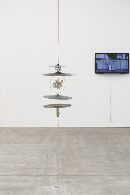 Bena Jackson and Teresa Collins, Molly's gift, 2021, cymbals, foam, washers, cable, glass, fake flowers. Image courtesy of Cheska Brown.