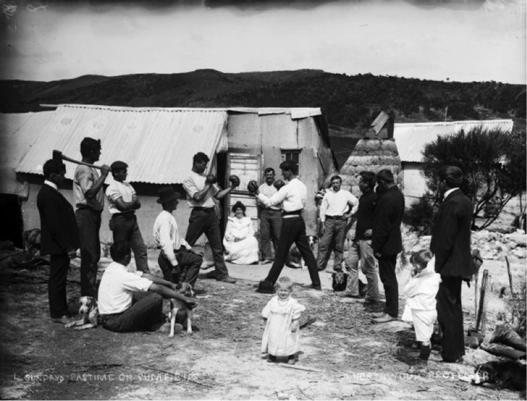 Group watching a boxing match on a gum field. Northwood brothers: Photographs of Northland. Ref: 1/1-011205-G. Alexander Turnbull Library, Wellington, New Zealand. http://natlib.govt.nz/records/22795592. Permission of the Alexander Turnbull Library, Wellington, New Zealand, must be obtained before any reuse of this image.