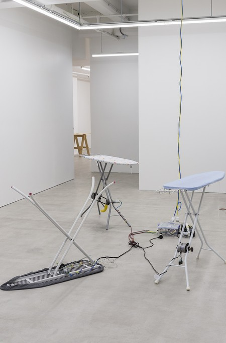 David Ed Cooper, New Bruxism, 2019, ironing boards, dc/ac motors, transmission, banana, cable, shackle bolt, tupperware, arduino, 5v relay, motor speed controllers, power supply. Image courtesy of Cheska Brown.