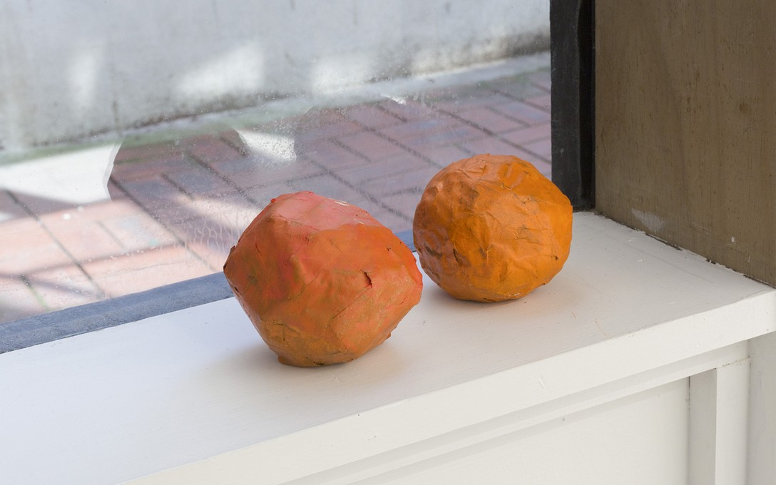 Bena Jackson and Teresa Collins, Oranges (x2), 2021, paper mache. Image courtesy of Cheska Brown.