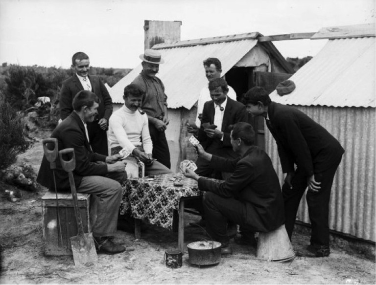 Gum diggers playing cards in camp. Northwood brothers: Photographs of Northland. Ref: 1/1-011230-G. Alexander Turnbull Library, Wellington, New Zealand. http://natlib.govt.nz/records/23226852. Permission of the Alexander Turnbull Library, Wellington, New Zealand, must be obtained before any reuse of this image.
