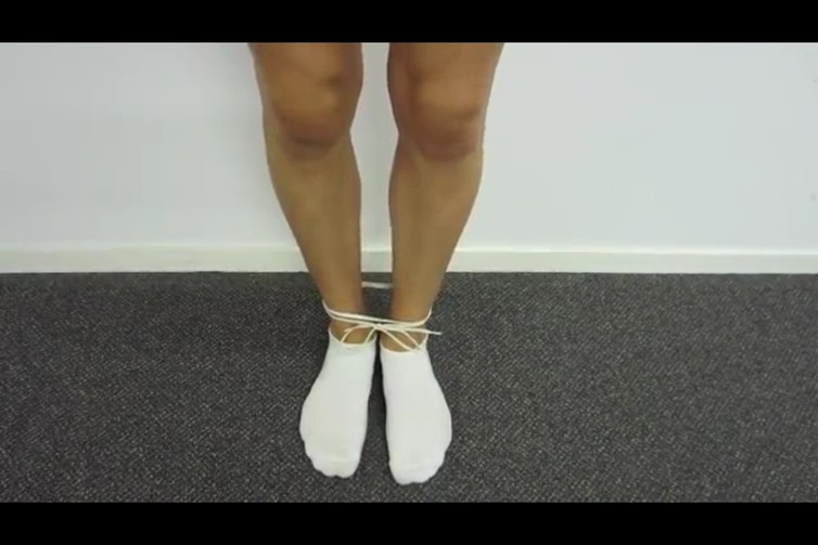Ankles Tied, 2014, (still image), 4th attempt white